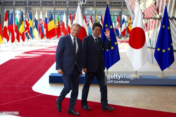 Japanese Prime Minister Shinzo Abe waves next to European Council President Donald Tusk at the European Council on July 6 2017 in Brussels Japanese...