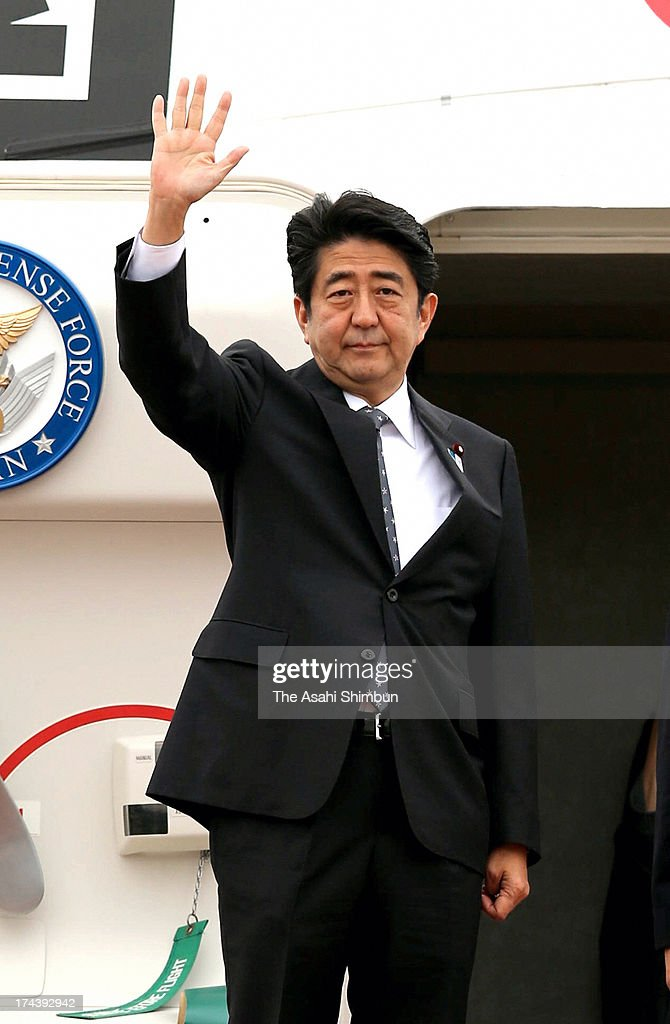 Japanese Prime Minister Shinzo Abe waves on departure for malaysia at Tokyo International Airport on July 25, 2013 in Tokyo, Japan. Abe will visits Malaysia, Singapore and the Philippines.
