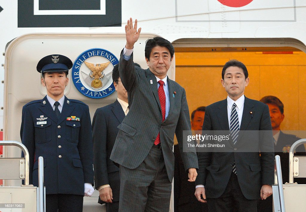Japanese Prime Minister Shinzo Abe waves upon departure at Tokyo International Airport on February 21, 2013 in Tokyo, Japan. Abe will be in the United States and holds a summit meeting with U.S. President Barack Obama.