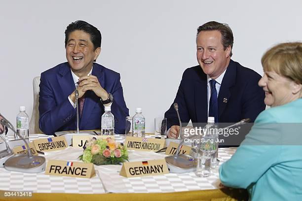 Japanese Prime Minister Shizo Abe British Prime Minister David Cameron and German Chancellor Angela Merkel attend the Japan EU EPA/FTA meeting on May...