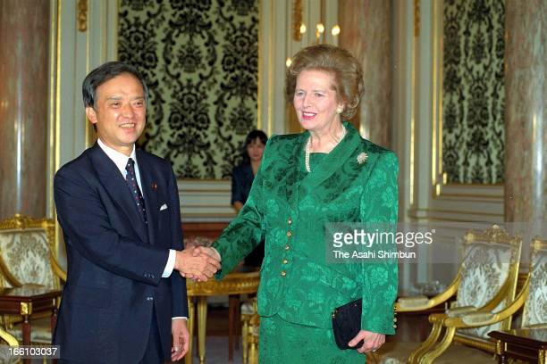 Japanese Prime Minister Toshiki Kaifu and British Prime Minister Margaret Thatcher shake hands prior to their summit meeting at Akasaka Palace on...