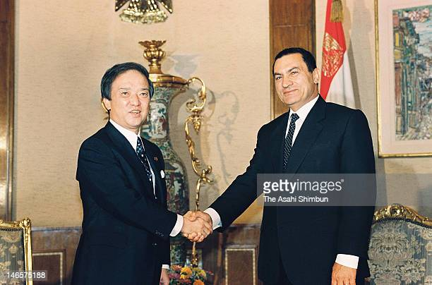 Japanese Prime Minister Toshiki Kaifu shakes hands with Egyptian President Hosni Mubarak at Mubarak's official residence on October 2 1990 in Cairo...