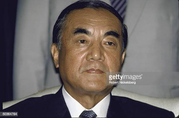 Japanese Prime Minister Yasuhiro Nakasone posing for a picture during a celebration