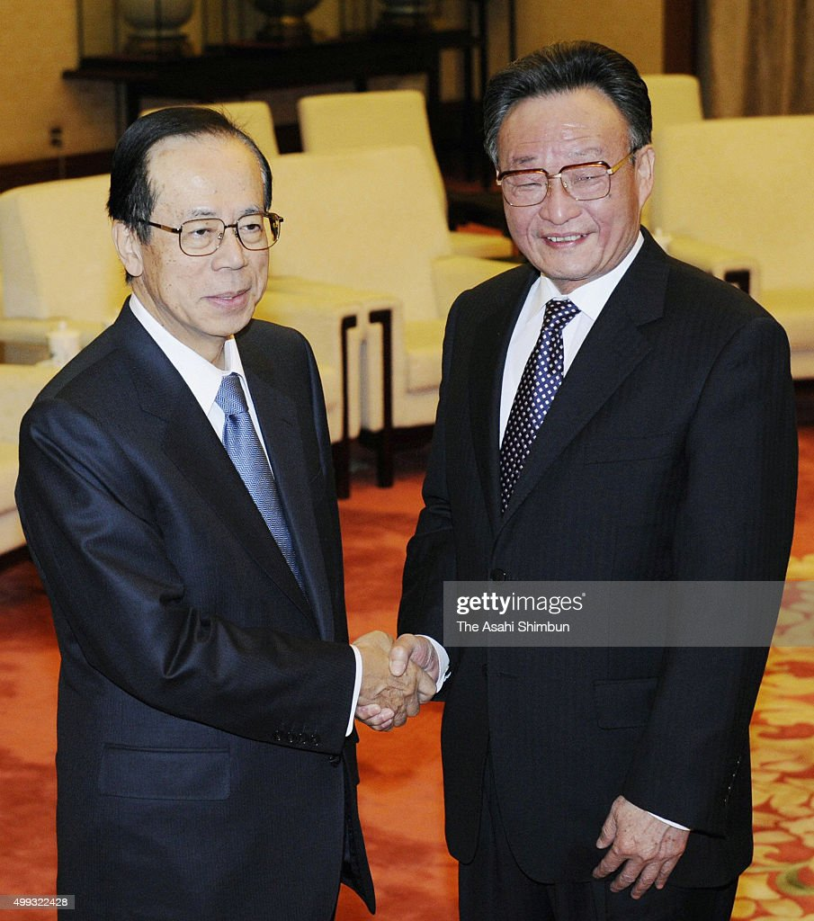 Japanese Prime Minister Yasuo Fukuda and Chairman and Party secretary of the Standing Committee of the National People's Congress Wu Bangguo shake...