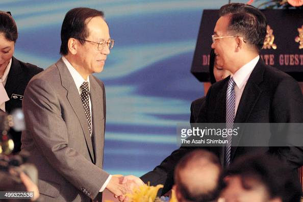 Japanese Prime Minister Yasuo Fukuda and Chinese Premier Wen Jiabao shake hands during a breakfast meeting at theDiaoyutai State Guesthouse on...