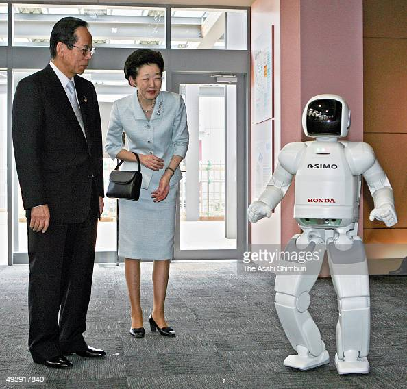 Japanese Prime Minister Yasuo Fukuda and his wife Kiyoko listen to the explanation of the humanoid robot Asimo at the International Media Center...