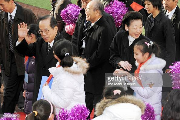 Japanese Prime Minister Yasuo Fukuda and his wife Kiyoko visit an elementary school on December 29 2007 in Beijing China