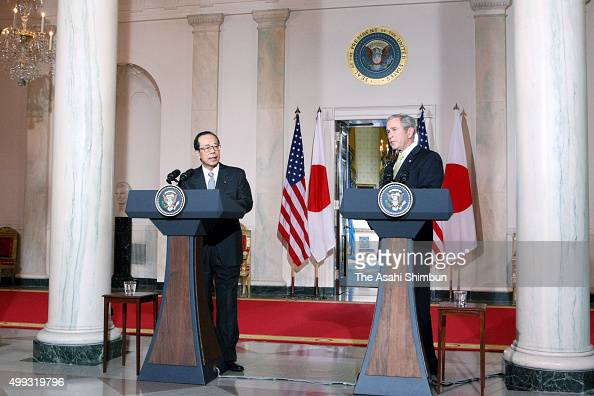 Japanese Prime Minister Yasuo Fukuda and US President Goerge W Bush attend a joint press conference after their meeting at the White House on...