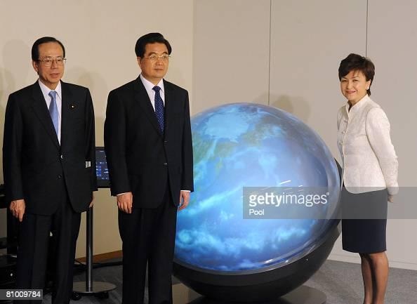 Japanese Prime Minister Yasuo Fukuda Chinese President Hu Jintao and NGO GAIA INITIATIVE Chairman and former Sanyo Corp President Tomoya Nonaka stand...