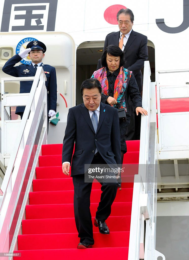 Japanese Prime Minister <a gi-track='captionPersonalityLinkClicked' href=/galleries/search?phrase=Yoshihiko+Noda&family=editorial&specificpeople=6441440 ng-click='$event.stopPropagation()'>Yoshihiko Noda</a> and his wife Hitomi are seen upon arrival at Phnom Penh International Airport on November 18, 2012 in Phnom Penh, Cambodia. PM Noda is in Combodia to attend the ASEAN (Association of South]East Asian Nations) meeting, also to meet U.S. president Barack Obama and attend the East Asian Summit.