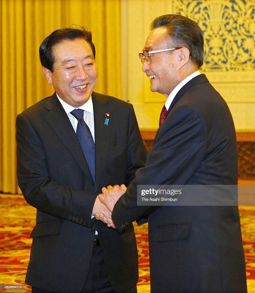 Japanese Prime Minister Yoshihiko Noda and Standing Committee of the National People's Congress Chairman Wu Bangguo shake hands during their meeting...