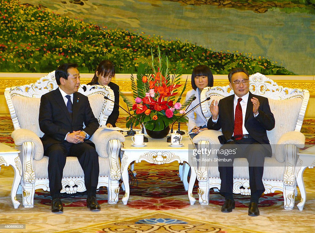 Japanese Prime Minister Yoshihiko Noda and Standing Committee of the National People's Congress Chairman Wu Bangguo talk during their meeting at the...