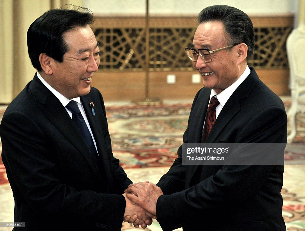 Japanese Prime Minister Yoshihiko Noda and Standing Committee of the National People's Congress Chairman Wu Bangguo shak hands at the Great Hall of...
