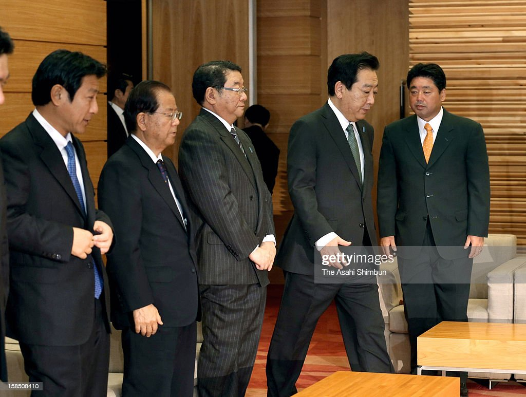 Japanese Prime Minister Yoshihiko Noda (2R, won in his constituency at general election) enters to a meeting room while Home Affiars Minister Shinji Tarutoko (1L, lost), Justice Minister Makoto Taki (2L, retiring), Chief Cabinet Secretary Osamu Fujimura (3L, lost) and Postal Privatization Minister Mikio Shimoji (1R, lost) stand prior to the cabinet members meeting at Noda's official residence on December 18, 2012 in Tokyo, Japan. Eight incumbent ministers lost their seats at the general election.