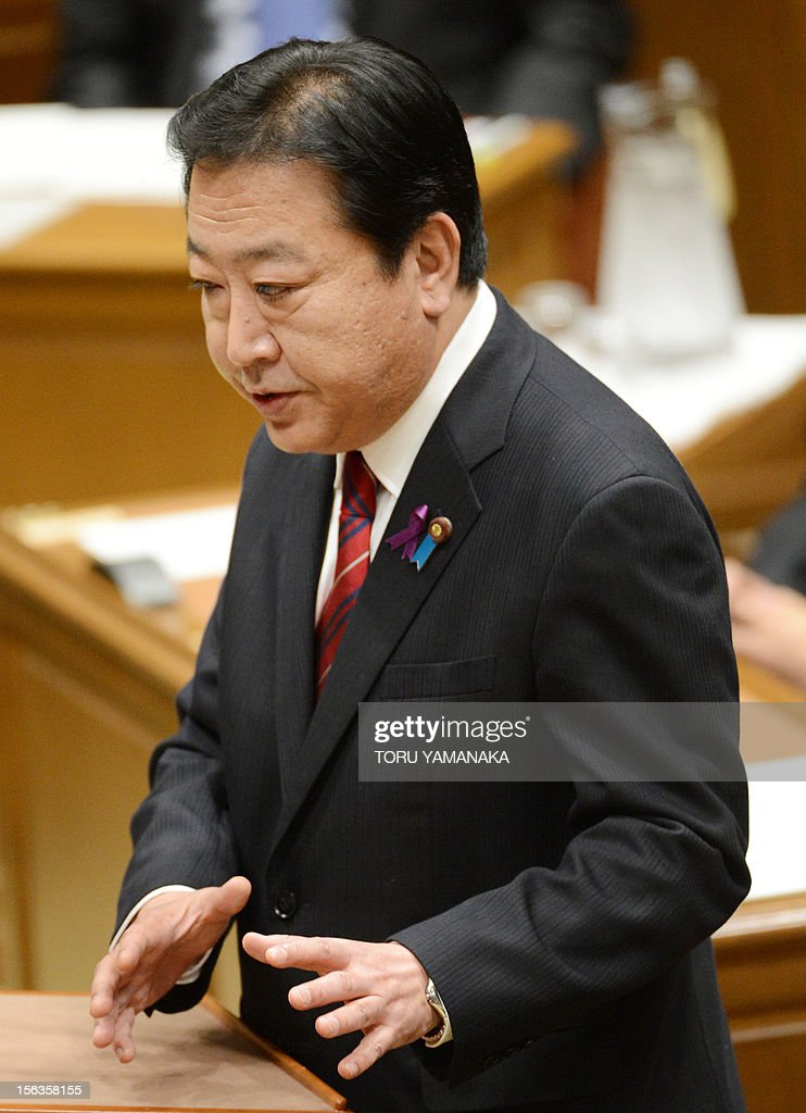 Japanese Prime Minister Yoshihiko Noda gestures during a one-by-one debate with President of the main opposition Liberal Democratic Party (LDP) Shinzo Abe at the lower house on November 14, 2012. Noda said on November 14 he will dissolve parliament on November 16 to hold an election if his opponents play ball on reforming the electoral system. AFP PHOTO / Toru YAMANAKA