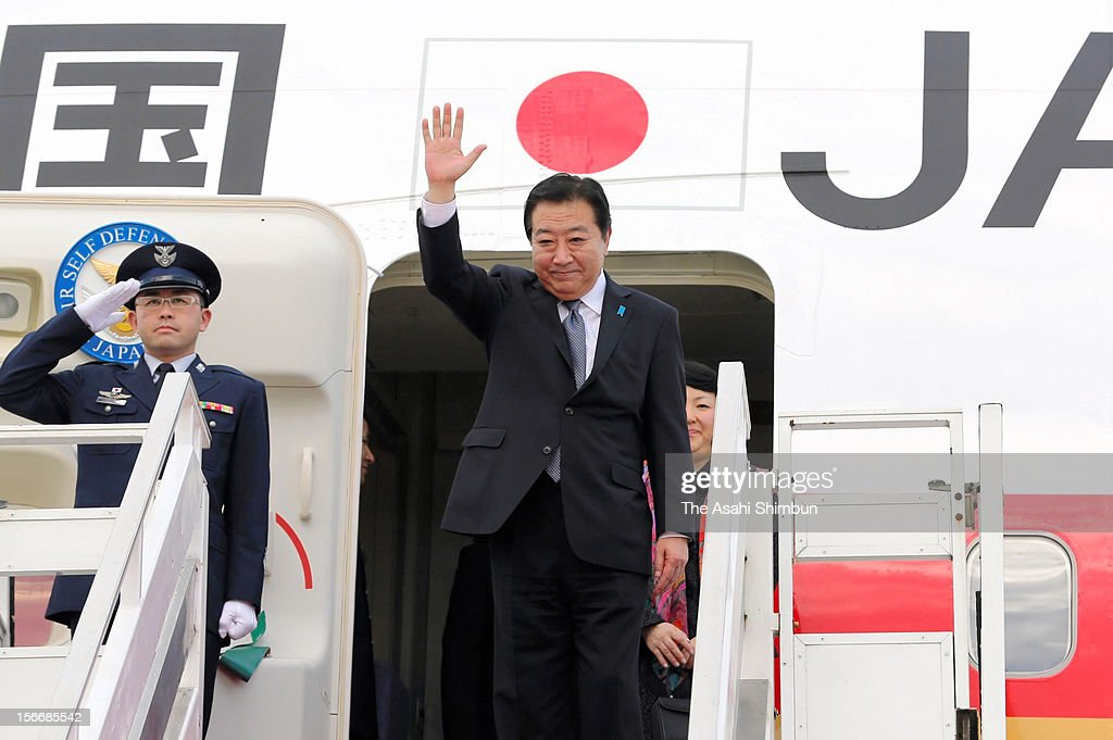 Japanese Prime Minister <a gi-track='captionPersonalityLinkClicked' href=/galleries/search?phrase=Yoshihiko+Noda&family=editorial&specificpeople=6441440 ng-click='$event.stopPropagation()'>Yoshihiko Noda</a> is seen upon arrival at Phnom Penh International Airport on November 18, 2012 in Phnom Penh, Cambodia. PM Noda is in Combodia to attend the ASEAN (Association of South]East Asian Nations) meeting, also to meet U.S. president Barack Obama and attend the East Asian Summit.