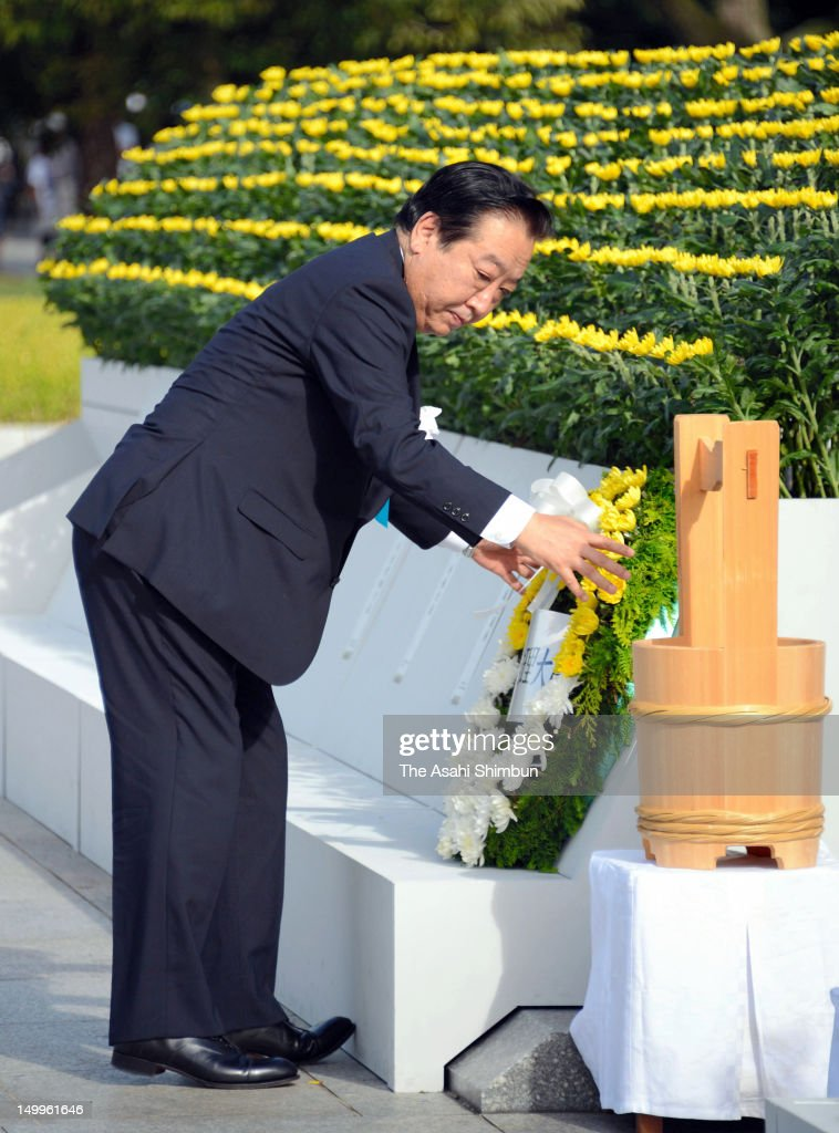 Japanese Prime Minister <a gi-track='captionPersonalityLinkClicked' href=/galleries/search?phrase=Yoshihiko+Noda&family=editorial&specificpeople=6441440 ng-click='$event.stopPropagation()'>Yoshihiko Noda</a> offers a flower bunch during the Hiroshima Peace Memorial at Hiroshima Peace Memorial Park on August 6, 2012 in Hiroshima, Japan. Hiroshima marks the 67th anniversary of its atomic bombing under the shadow of the Fukushima nuclear disaster and by issuing a plea for complete nuclear disarmament.