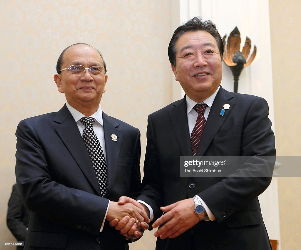 Japanese Prime Minister <a gi-track='captionPersonalityLinkClicked' href=/galleries/search?phrase=Yoshihiko+Noda&family=editorial&specificpeople=6441440 ng-click='$event.stopPropagation()'>Yoshihiko Noda</a> shakes hands with Myanmar Presindent <a gi-track='captionPersonalityLinkClicked' href=/galleries/search?phrase=Thein+Sein&family=editorial&specificpeople=787536 ng-click='$event.stopPropagation()'>Thein Sein</a> during their bilateral meeting on November 18, 2012 in Phnom Penh, Cambodia. Japan will provide new yen loans worth about 50 billion yen to Myanmar from next spring.