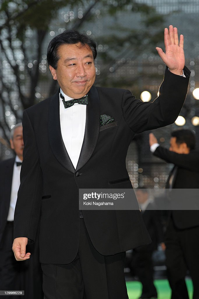 Japanese Prime Minister <a gi-track='captionPersonalityLinkClicked' href=/galleries/search?phrase=Yoshihiko+Noda&family=editorial&specificpeople=6441440 ng-click='$event.stopPropagation()'>Yoshihiko Noda</a> waves on the green carpet during the Tokyo International Film Festival Opening Ceremony at Roppongi Hills on October 22, 2011 in Tokyo, Japan.