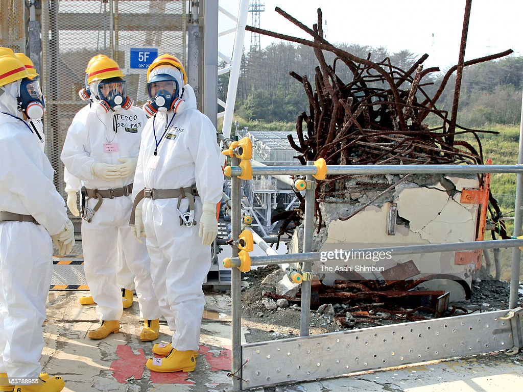 Japanese Prime Minister Yoshihiko Noda (1R), wearing radiation protection gears inspects crippled Tokyo Electric Power Co., Fukushima Daiichi Nuclear Power Plant on October 7, 2012 in Okuma, Fukushima, Japan. Noda ordered officials to accelerate decontamination efforts.