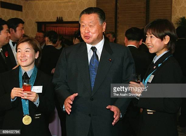 Japanese Prime Minister Yoshiro Mori talks with Judo Women's 48kg gold mdealist Ryoko Tamura and women's marathon gold medalist Naoko Takahashi...