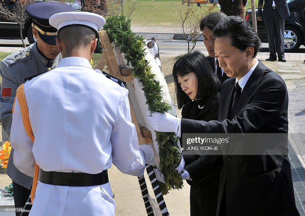 Japanese Prime Minister Yukio Hatoyama (R) and his wife Miyuki (2nd R) offer flowers to the 46 sailors killed in the March, sinking of a South Korean warship, at a national cemetery in Daejeon, south of Seoul, on May 29, 2010. Hatoyama arrived in South Korea for a two-day stay to attend an annual summit with the leaders of South Korea and China.