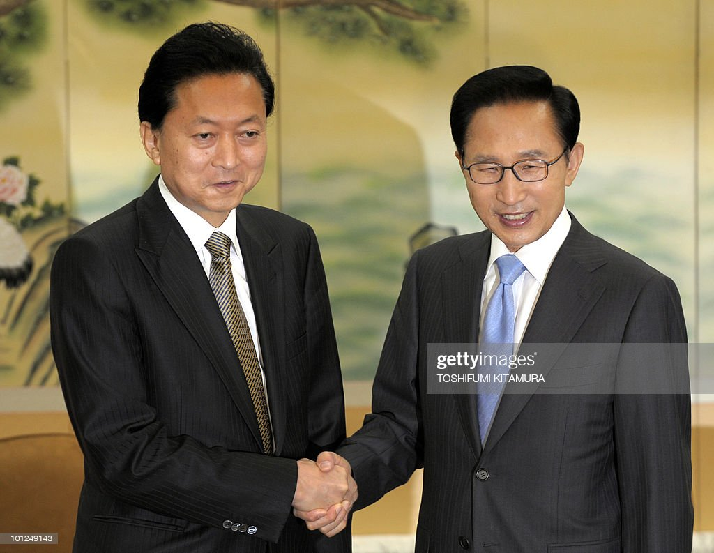 Japanese Prime Minister Yukio Hatoyama (L) is welcomed by South Korean President Lee Myung-Bak (R) prior to their talks at a hotel in Seogwipo city, Jeju island, on May 29, 2010. Hatoyama, Chinese Premier Wen Jiabao and South Korean President Lee Myung-Bak will meet in a three-way summit, amid high tensions on the Korean peninsula. The two-day talks on the South Korean holiday island of Jeju are likely to focus on China's ally North Korea after an investigation found Pyongyang was responsible for the sinking of a South Korean warship that left 46 dead.