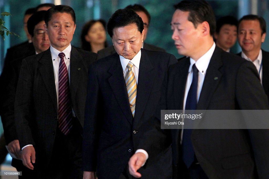 Japanese Prime Minister Yukio Hatoyama (C) leaves his official residence after speaking to the media on June 2, 2010 in Tokyo, Japan. Hatoyama announced he is to step down as Japan's Prime Minister.