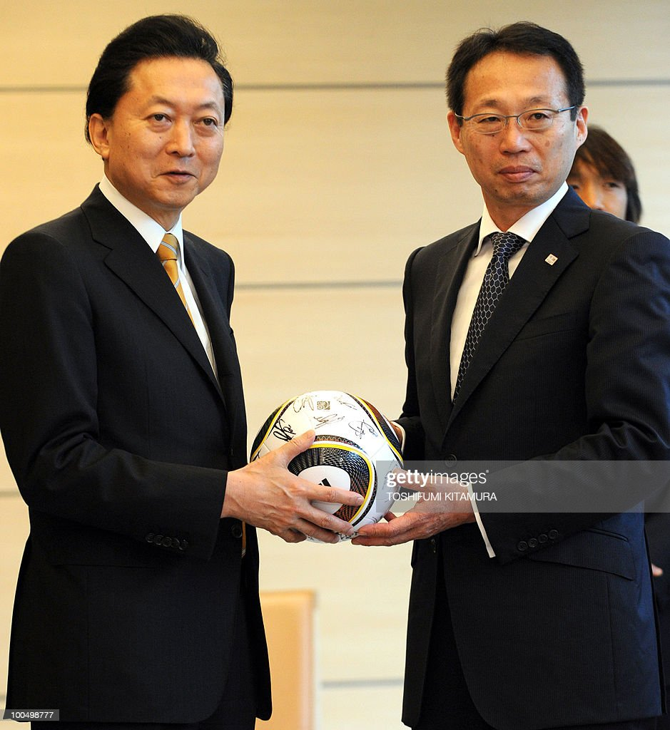 Japanese Prime Minister Yukio Hatoyama (L) receives a signed ball from Japan National Football team head coach Takeshi Okada (R) at Hatoyama's official residence in Tokyo on May 25, 2010. The team will leave here on May 26 for a Switzerland based camp before joining the 2010 FIFA World Cup in South Africa.
