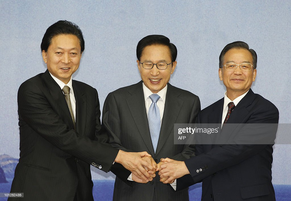 Japanese Prime Minister Yukio Hatoyama, South Korean President Lee Myung-bak and Chinese Premier Wen Jiabao pose before their summit in Seogwipo on Jeju island, south of Seoul on May 29, 2010. China came under intensified pressure from South Korea and Japan on Saturday to join global efforts to punish North Korea over the sinking of a South Korean warship in March.