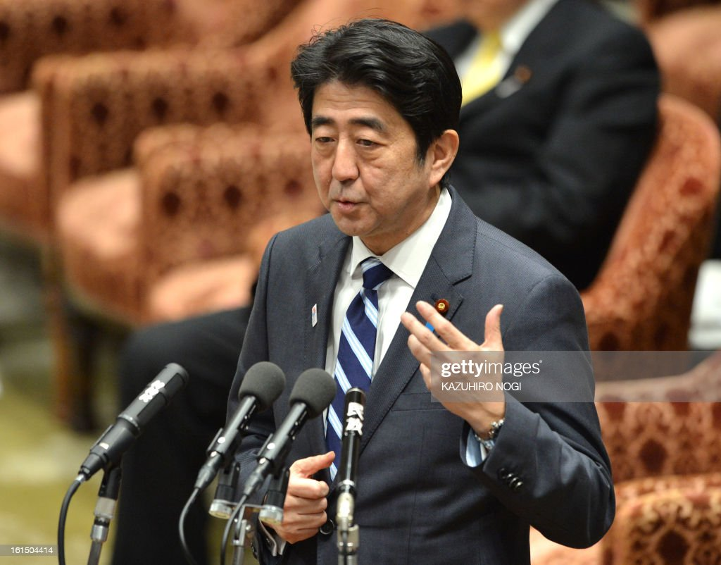 Japanese Prime Minsiter Shinzo Abe answers questions during a budget committee session of the lower house at parliament in Tokyo on February 12, 2013. AFP PHOTO / KAZUHIRO NOGI