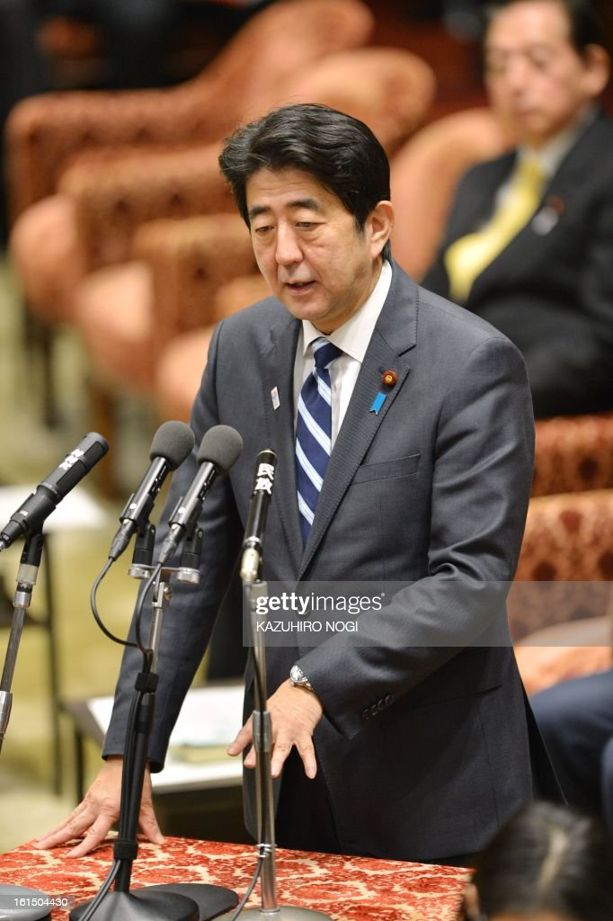 Japanese Prime Minsiter Shinzo Abe answers questions during a budget committee session of the lower house at parliament in Tokyo on February 12, 2013.