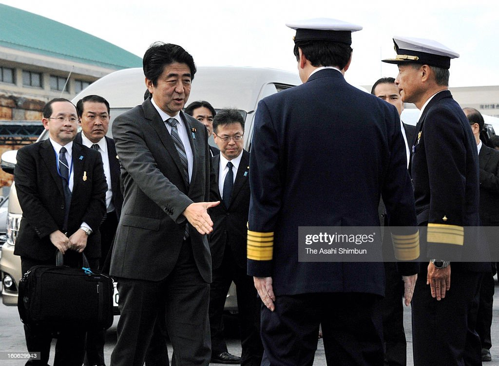 Japanese Prime Minsiter <a gi-track='captionPersonalityLinkClicked' href=/galleries/search?phrase=Shinzo+Abe&family=editorial&specificpeople=559017 ng-click='$event.stopPropagation()'>Shinzo Abe</a> encourages Coast Guard officers by paying a visit to their patrol ship Motobu, which is going on duty in the disputed Senkaku/Diaoyu sea at Naha Port on February 2, 2013 in Naha, Okinawa, Japan. Abe visits Okinawa for the first time after taking office in December.