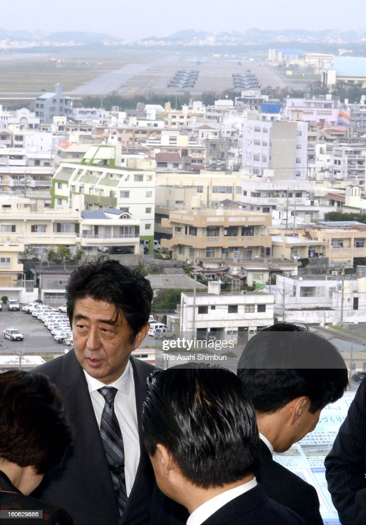 Japanese Prime Minsiter <a gi-track='captionPersonalityLinkClicked' href=/galleries/search?phrase=Shinzo+Abe&family=editorial&specificpeople=559017 ng-click='$event.stopPropagation()'>Shinzo Abe</a> inspects the U.S. Marine Corps Futenma Air Station on February 2, 2013 in Ginowan, Okinawa, Japan. Abe visits Okinawa for the first time after taking office in December.