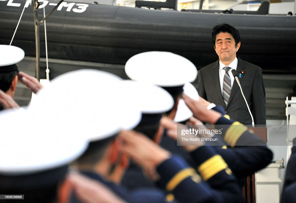 Japanese Prime Minsiter <a gi-track='captionPersonalityLinkClicked' href=/galleries/search?phrase=Shinzo+Abe&family=editorial&specificpeople=559017 ng-click='$event.stopPropagation()'>Shinzo Abe</a> ncourages Coast Guard officers by paying a visit to their patrol ship Motobu, which is going on duty in the disputed Senkaku/Diaoyu sea at Naha Port on February 2, 2013 in Naha, Okinawa, Japan. Abe visits Okinawa for the first time after taking office in December.