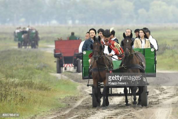 Japanese Prince Akishino and his daughter Princess Mako take a coach ride at a farm in Bugac Hungary on Aug 20 2017 Their trip comes prior to her...