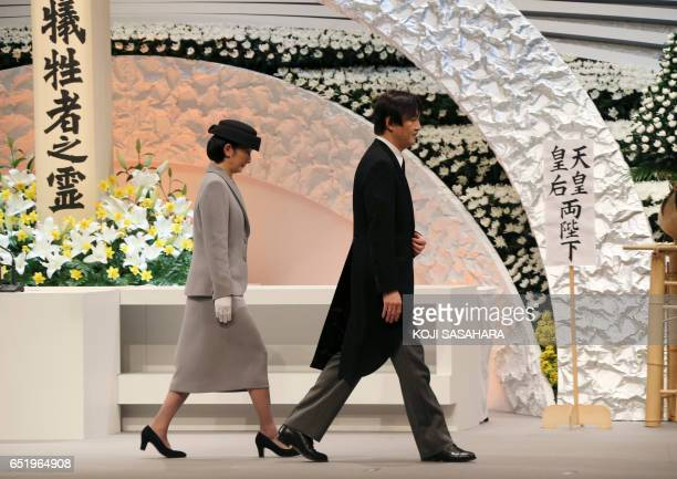 Japanese Prince Akishino and Princess Kiko walk in front of the altar for victims of the March 11 2011 earthquake and tsunami after the prince...