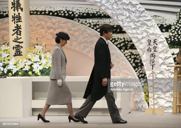 Japanese Prince Akishino and Princess Kiko walk in front of the altar for the victims of the March 11 2011 earthquake and tsunami after the prince...