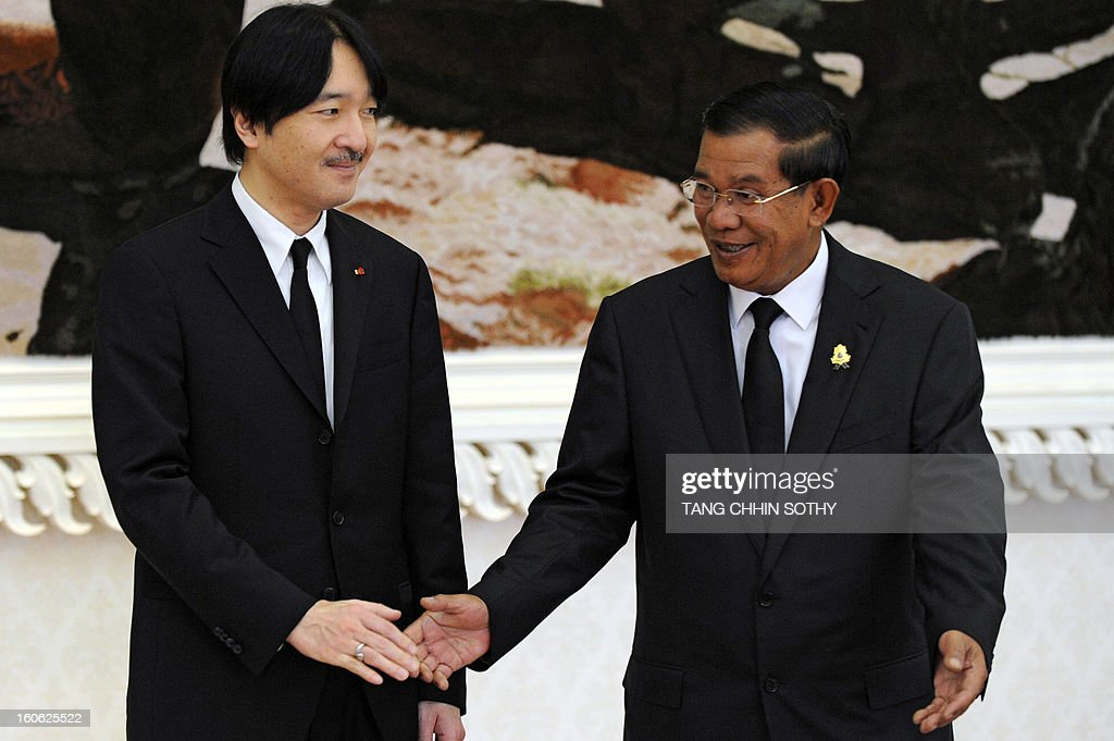Japanese Prince Akishino (L) is welcomed by Cambodian Prime Minister Hun Sen (R) during their meeting at the Peace Palace in Phnom Penh on February 4, 2013. Akishino arrived here to pay his respects and attend the funeral of the late former king Norodom Sihanouk ahead of his cremation on February 4.