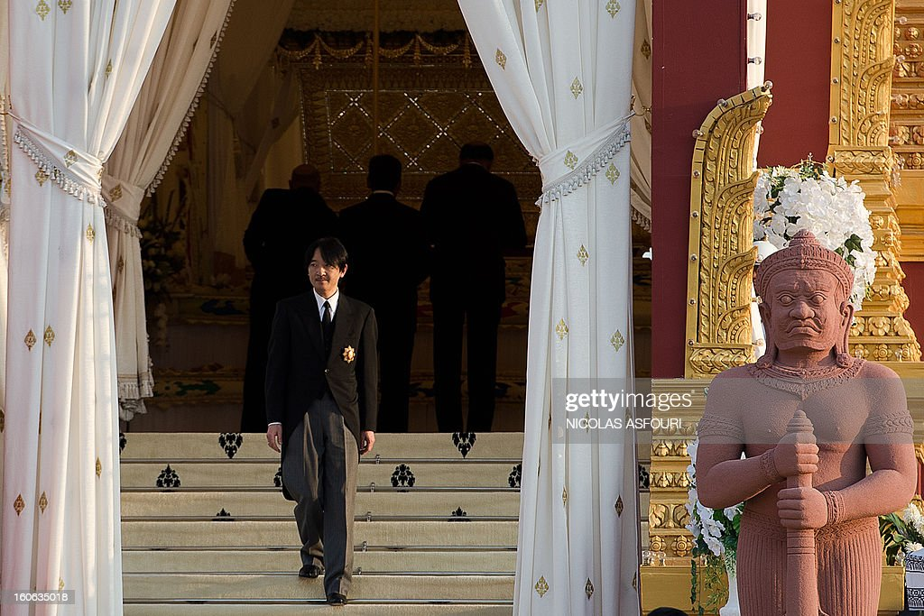 Japanese Prince Akishino leaves the crematorium where a coffin bearing the remains of Cambodia's late King Norodom Sihanouk is placed before his cremation, near the Royal Palace in Phnom Penh on February 4, 2013. Thousands of mourners massed in the Cambodian capital as the kingdom cremated its revered former King Norodom Sihanouk, who steered his country through six turbulent decades. AFP PHOTO/ Nicolas ASFOURI