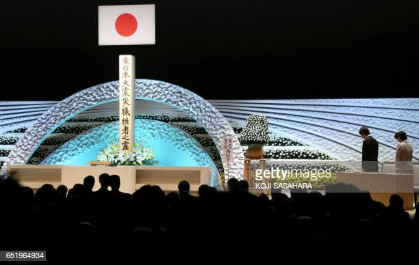Japanese Prince Akishino Princess Kiko and participants offer a moment of silence in front of an altar for the victims of the March 11 2011...