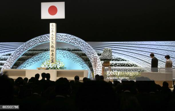 Japanese Prince Akishino second from right Princess Kiko right and participants offer a moment of silence in front of an altar for the victims of the...