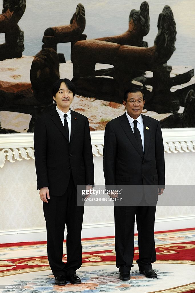 Japanese Prince Akishino (L) stands with Cambodian Prime Minister Hun Sen (R) during their meeting at the Peace Palace in Phnom Penh on February 4, 2013. Akishino arrived here to pay his respects and attend the funeral of the late former king Norodom Sihanouk ahead of his cremation on February 4.