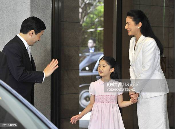 Japanese Princess Aiko and Crown Princess Masako see off Crown Prince Naruhito at the entrance of the Togu Palace in Tokyo on July 30 2008 Naruhito...