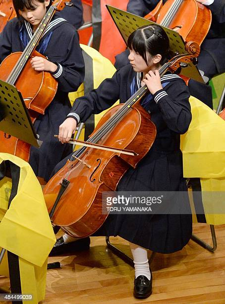 Japanese Princess Aiko plays the cello on stage during an annual concert by students and graduates at Gakushuin University in Tokyo on April 13 2014...