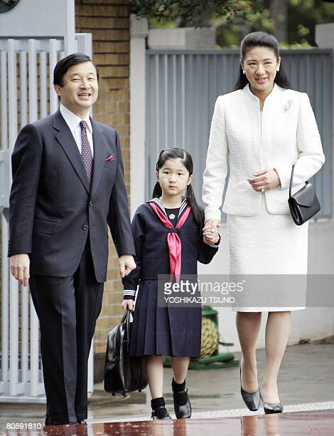 Japanese Princess Aiko walks with her parents Crown Prince Naruhito and Crown Princess Masako as she enters the Gakushuin elementary school in Tokyo...