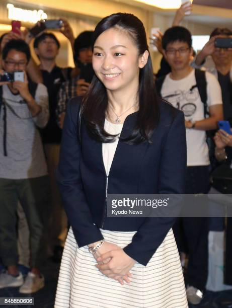 Japanese Princess Kako granddaughter of Emperor Akihito and Empress Michiko is pictured at Tokyo's Haneda airport on Sept 12 before departing for...