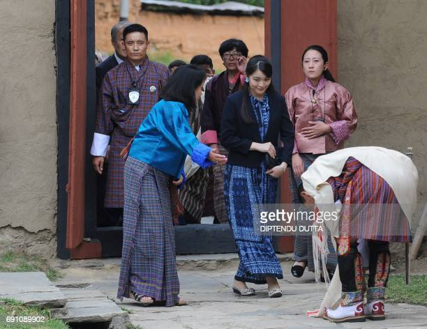 Japanese Princess Mako is welcomed by Bhutanese delegates at a Folk Heritage Museum in Thimpu on June 1 2017 Japanese Princess Mako the oldest of...
