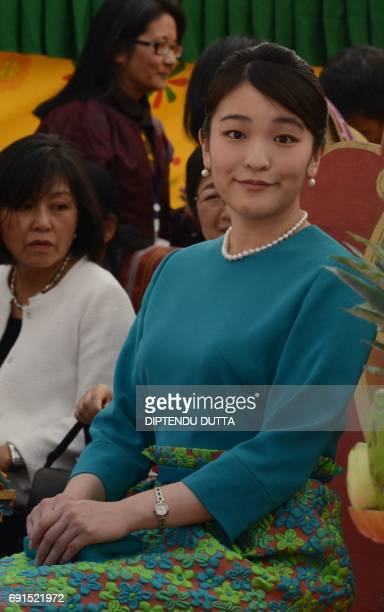 Japanese Princess Mako looks on ahead of the opening ceremony for 'Japan Week' at the Clock Tower in the Bhutanese capital Thimpu on June 2 2017...