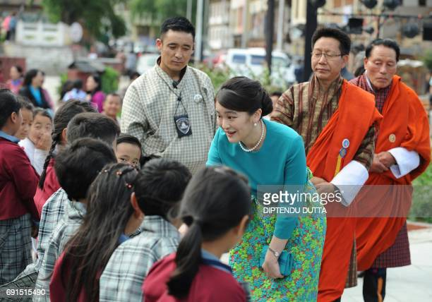 Japanese Princess Mako meets Bhutanese shcoolchildren due to perform at the opening ceremony for 'Japan Week' at the Clock Tower in Thimpu on June 2...